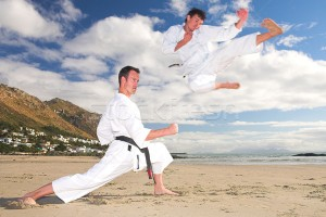 270010_stock-photo-men-practicing-karate-on-the-beach